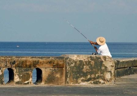 Fishing on the Malecon seawall, photo: Bill Hackwell