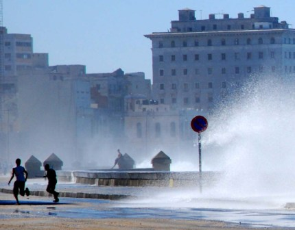 Waves over Havana's Malecon Seawall.  Photo: Caridad