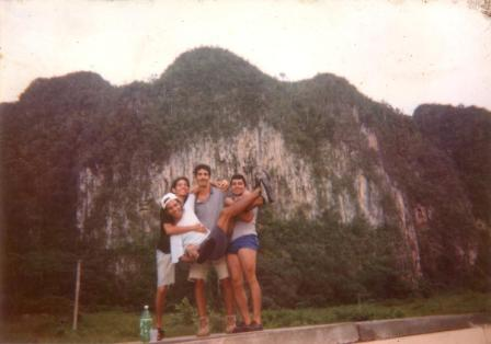 Dago and friends and one of Viñales famous limestone outcrops
