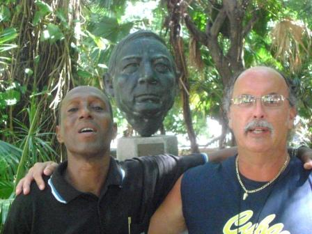 With a history student at the University of Havana campus in front of their statue of Benito Juarez.