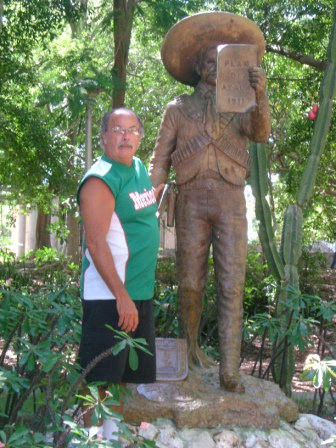 In front of a statue of the great Mexican revolutionary Emiliano Zapata in a park in Miramar.