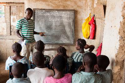 Solomon teaching a social studies class in the Mokpangumba school.