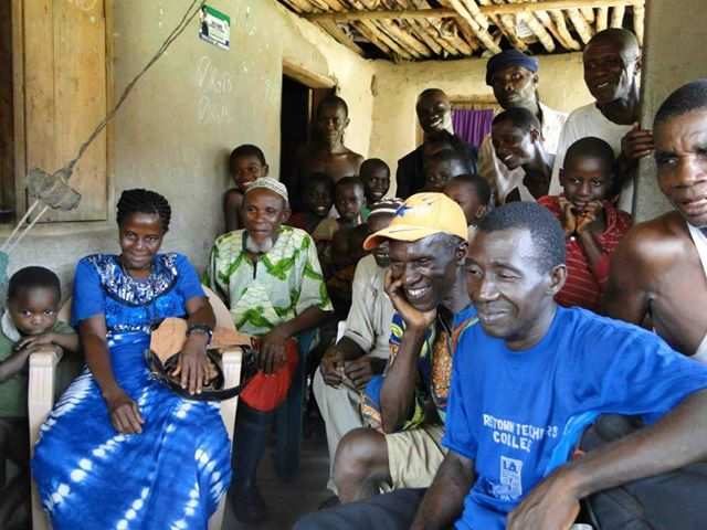 Members of the community of Mokpangumba, Upper Banta, Sierra Leone watch parts of the film premiered recently in Cuba.